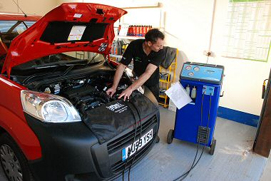 Paul works on the Air Conditioning system of a car in the Air Con Workshop